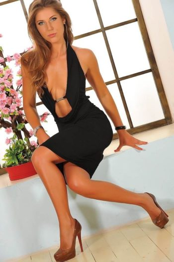Barbara modeling a black dress