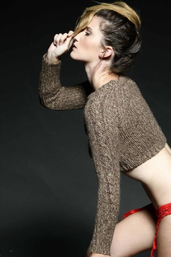 Elizabeth Arey wearing a sweater and red lingerie