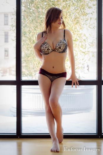 Hali Slone wearing underwear next to a window