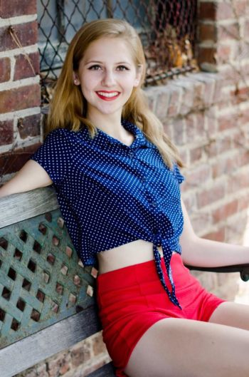 Hannah True modeling red shorts