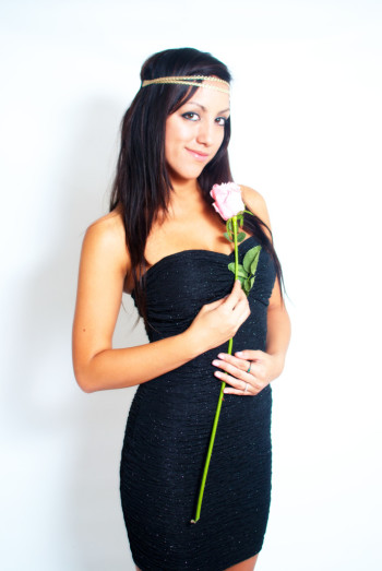 Heather Marie Stephenson wearing a black dress with a rose