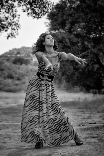 Indigenous Destiny wearing a long zebra dress