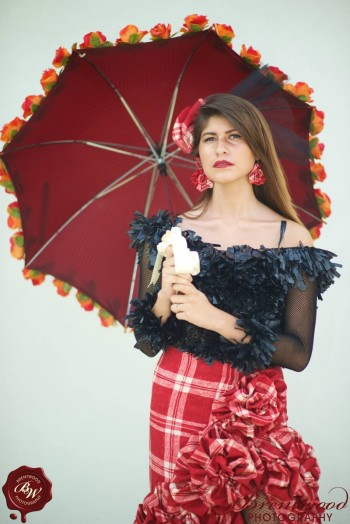 Isabel Martinho holding a red umbrella