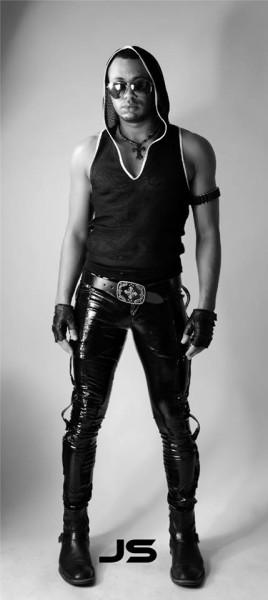 Jeffery Stephan wearing latex black pants
