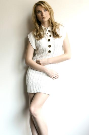 Kim Stephenson modeling a white miniskirt