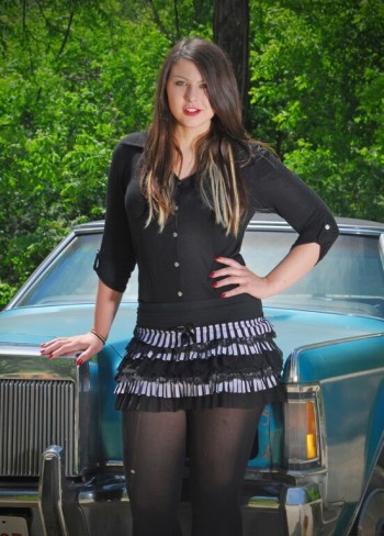 Kiri Ann Fischer modeling a black mini skirt