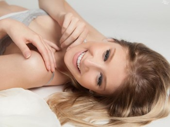 Kylie Smith lying on a white background