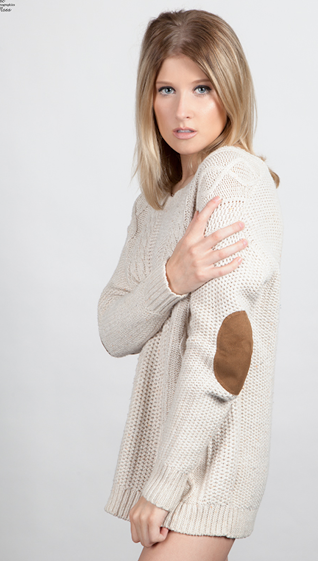 Kylie Smith wearing a white long sweater