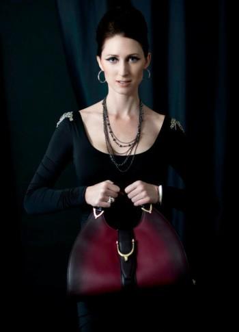 Lauren Ashlee Boyette holding a curvy handbag