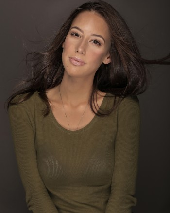 Mary Casarreal wearing a green sweater