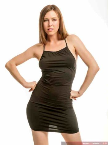 Megan Starr Loxx modeling a black dress