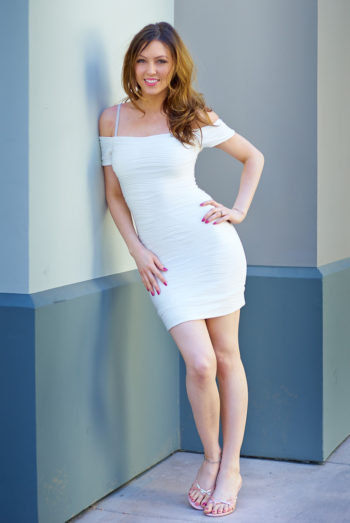 Megan Starr Loxx modeling a white dress