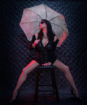 Sabrina-Cole modeling a black corset with an umbrella