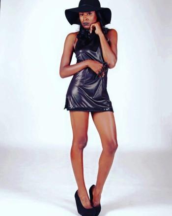 Seedy modeling a black skirt