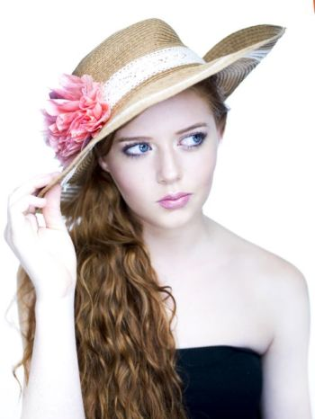 Sophia Harris showing her long hair and a hat